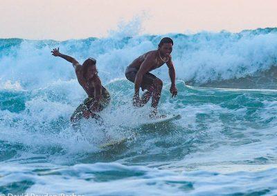 Surfers having fun at sunset.